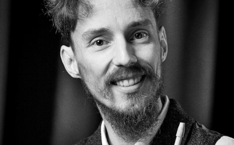 foto van de 18 minuten man, wouter blacquiere, gemaakt door charles keijser, in de theaterzaal van gruitpoort doetinchem